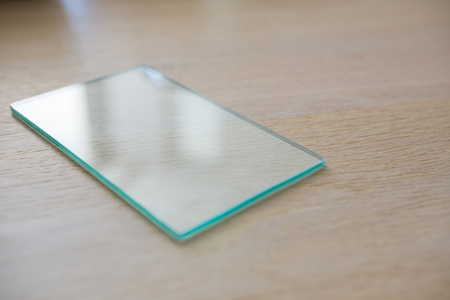 domicile: Piece of a glass on a table at home