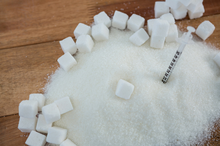 sugar powder: Close-up of syringe in sugar powder Stock Photo