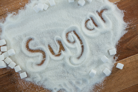 sugar powder: Close-up of sugar written on sugar powder