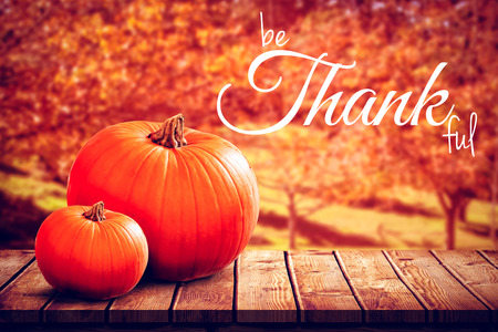 western script: Digital image of happy thanksgiving day text greeting against white background