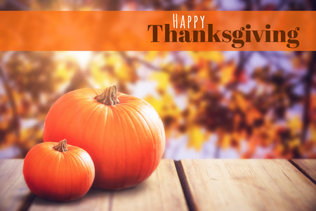 digitally generated image: Digitally generated image of happy thanksgiving text against close-up of pumpkin