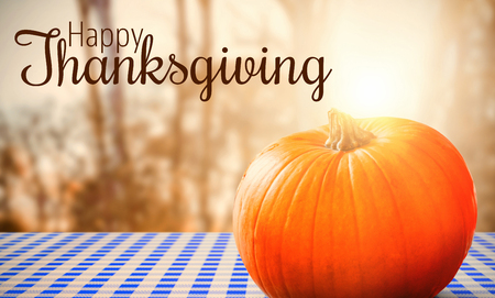 copy space: Thanksgiving greeting text against close-up of pumpkin
