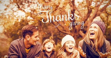 girl lying studio: Happy thanksgiving day message against smiling young family throwing leaves around