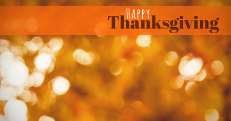 digitally generated image: Digitally generated image of happy thanksgiving text against defocused leaves Stock Photo