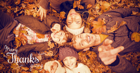 girl lying studio: Happy thanksgiving day message against smiling young family doing a head circles