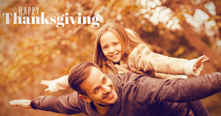 Digitally generated image of happy thanksgiving text against father and his daughter imitatimg plane