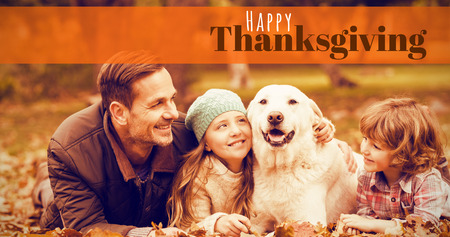 weekend activities: Digitally generated image of happy thanksgiving text against smiling young family with dog
