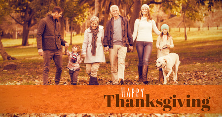 digitally generated image: Digitally generated image of happy thanksgiving text against smiling extended family walking together