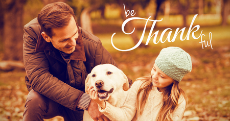 Digital image of happy thanksgiving day text greeting against young family with a dog Stock Photo