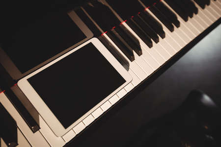 Close-up of piano keyboard in a studio