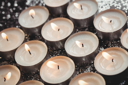Close-up of candles burning during christmas time
