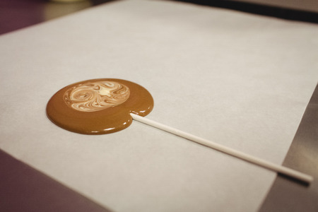 cake factory: Close-up of lollipop drying on wax paper in kitchen Stock Photo