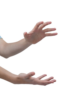 gesturing: Close-up of hands gesturing against white background