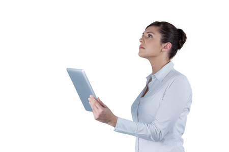 Businesswoman holding digital tablet against white background Stock Photo