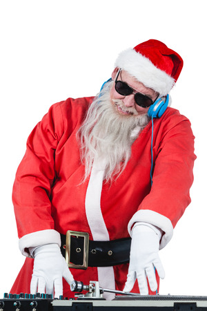 Santa claus playing a dj against white background Stock Photo