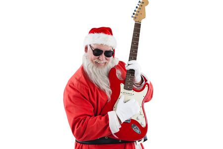 Smiling santa claus playing a guitar against white background