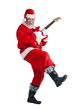 Portrait of smiling santa claus playing a guitar against white background Stock Photo