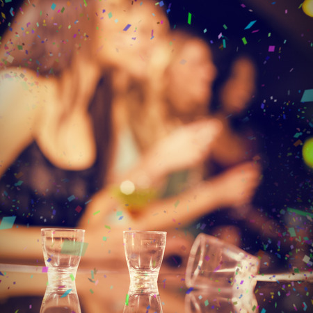 shooter: Three empty shooter glasses against flying colours Stock Photo