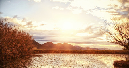 adventuring: Beautiful view of lake with mountains in background Stock Photo