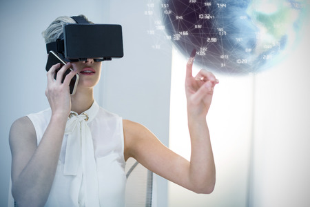 virtual reality simulator: Earth globe against businesswoman using virtual reality simulator and mobile phone Stock Photo