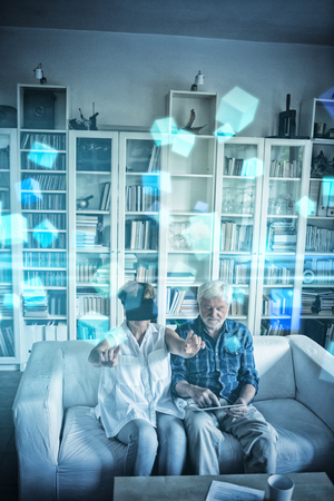 fishtank: Futuristic screen with quaders against senior couple using digital tablet and virtual reality headset Stock Photo