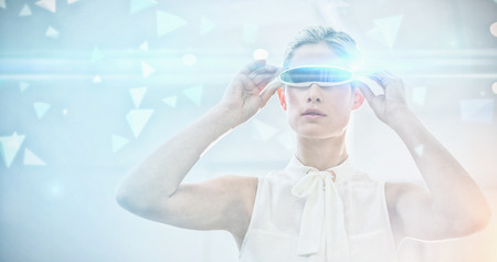 virtual reality simulator: Technical screen with little pyramids against businesswoman holding virtual reality simulator