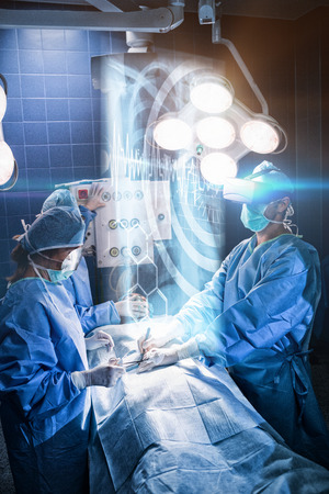 fishtank: Medical interface on xray against surgeons performing operation in room
