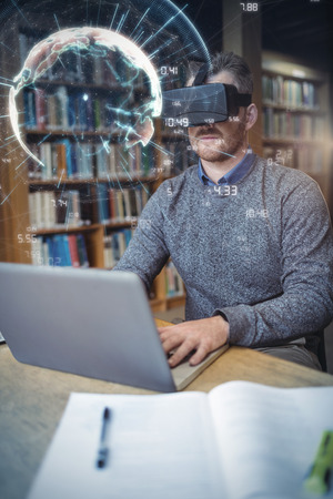 fishtank: Image of earth with different times against businessman using virtual reality simulator while working on laptop