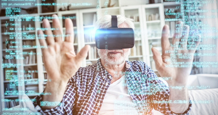 Blue programme against senior man wearing virtual reality headset in living room