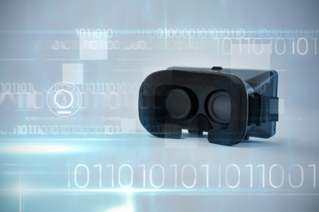 Blue technology design with binary code against close-up of virtual reality headset Stock Photo