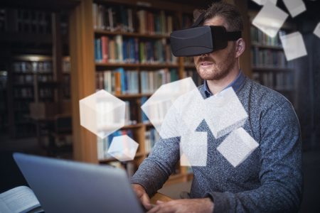 virtual reality simulator: Digitally generated grey cubes floating  against businessman working on laptop while using virtual reality simulator