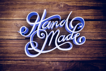 digitally generated image: Digitally generated image of hand made text against wooden background