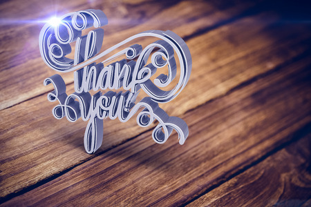 Digital image of thank you text against textured brown wooden floor