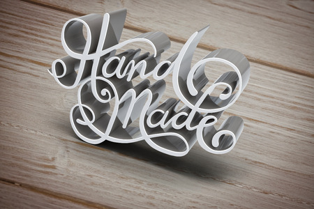 Three Dimensional of Hand made text against brown wooden background