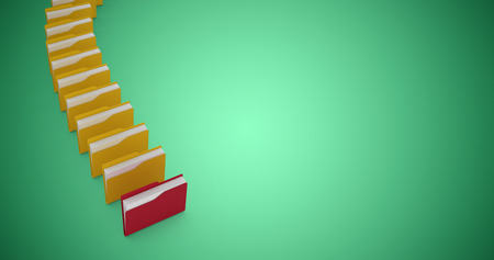 High angle view of folders in row against green vignette Stock Photo
