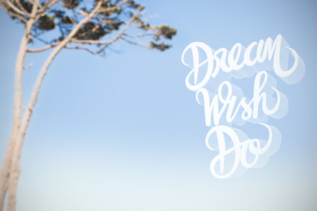 Illustration of dream wish do text over white screen against view of a tree