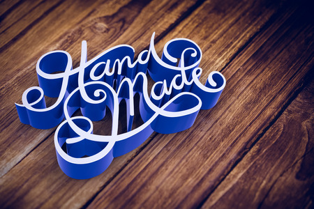 Illustration of of hand made text against wooden background