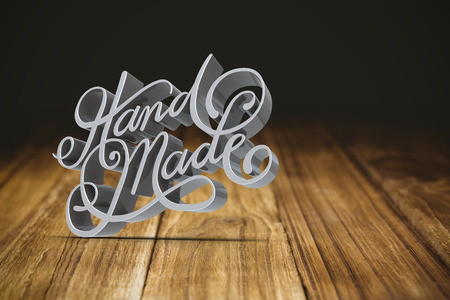 Hand made text against white screen against wooden table Stock Photo