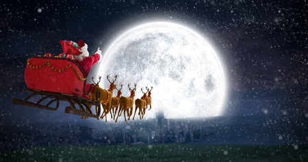 Santa Claus riding on sleigh with gift box against bright moon over city