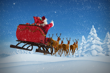 Santa Claus riding on sleigh with gift box against snowy landscape with fir trees