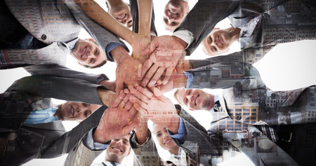 well dressed woman: Smiling business team standing in circle hands together against new york Stock Photo