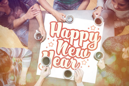 growth hot: People drinking coffee around new year message Stock Photo