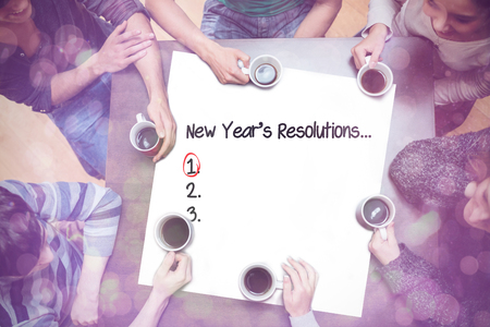 new years resolution: People sitting around table drinking coffee against new years resolution list