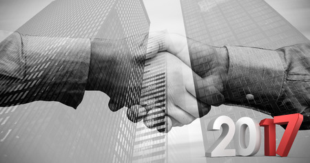 composite image: Composite image of gray and red numbers against composite image of hand shake in front of wires Stock Photo