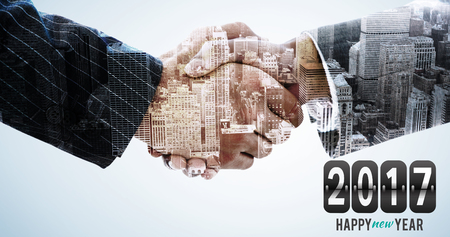 composite image: Composite image of numbers against composite image of hand shake in front of wires Stock Photo