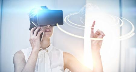 Digitally generated image of earth against businesswoman using virtual reality simulator and mobile phone Stock Photo