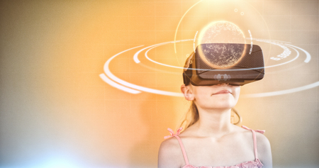 Digital image of globe with light trail against girl using a virtual reality device