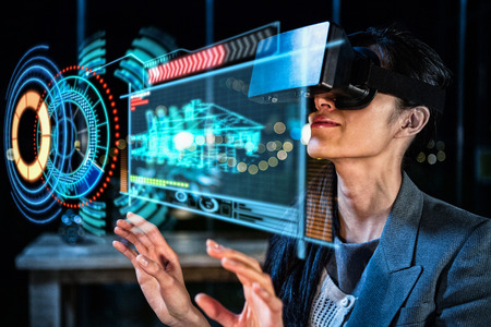 digital volume: Digitally generated image of volume dial with digital interface against businesswoman using virtual reality headset