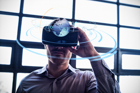light trail: Digitally generated image of earth with social connectivity and light trail against businessman using virtual reality device Stock Photo