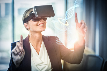 volume knob: Digitally generated image of illuminated volume knob with dna strand against businesswoman using the virtual reality headset Stock Photo